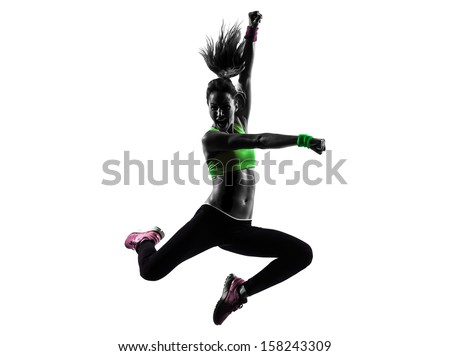 one caucasian woman exercising fitness dancing jumping in silhouette  on white background - stock photo