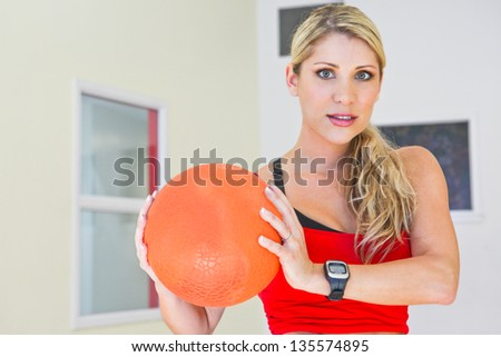 one caucasian woman exercising fitness holding a ball
