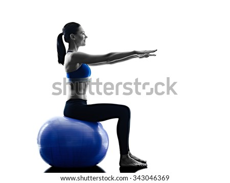 one caucasian woman exercising pilates ball exercises fitness in silhouette isolated on white backgound - stock photo