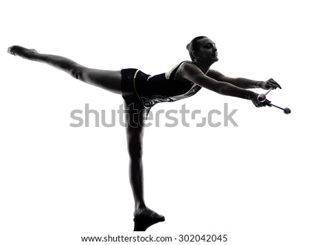 One caucasian woman exercising rhythmic gymnastics with ribbon in - Rhythmic Gymnastics Stock Photos Royalty Free Images