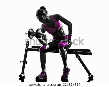 one caucasian woman exercising   weights body building fitness in studio silhouette isolated on white background - stock photo