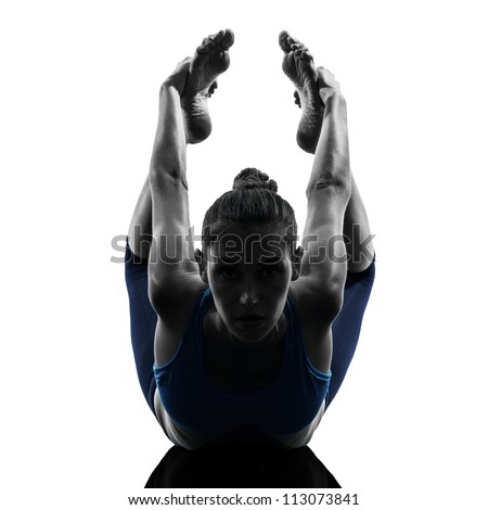 one caucasian woman exercising yoga  bow pose in silhouette studio isolated on white background - stock photo