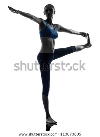 one caucasian woman exercising yoga Hasta Padangusthasana in silhouette studio isolated on white background - stock photo