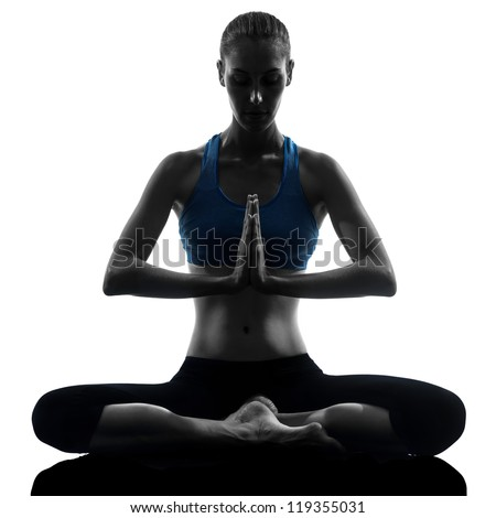 one caucasian woman exercising yoga meditating sitting hands joined in silhouette studio isolated on white background - stock photo