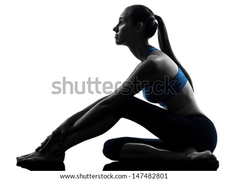 one caucasian woman exercising yoga sitting stretching in silhouette studio isolated on white background - stock photo