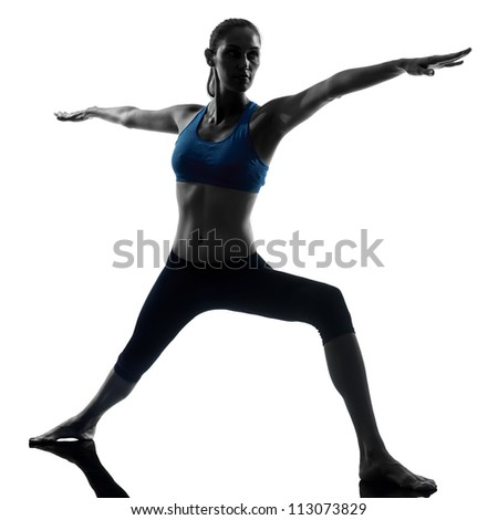 one caucasian woman exercising yoga warrior 2 position in silhouette studio isolated on white background - stock photo