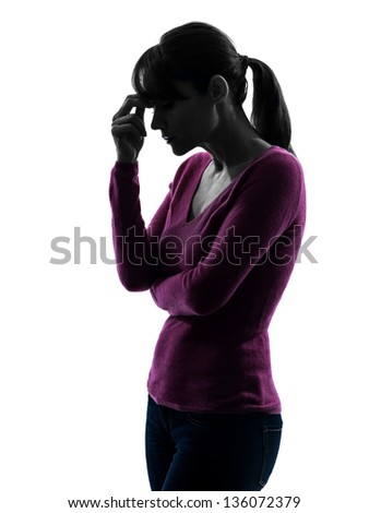 one caucasian woman migraine headache  in silhouette studio isolated on white background - stock photo