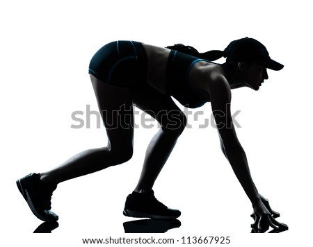 one caucasian woman runner jogger  on the starting block in silhouette studio isolated on white background - stock photo