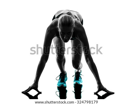 one caucasian woman runner running jogger jogging on starting blocks  in studio silhouette isolated on white background - stock photo