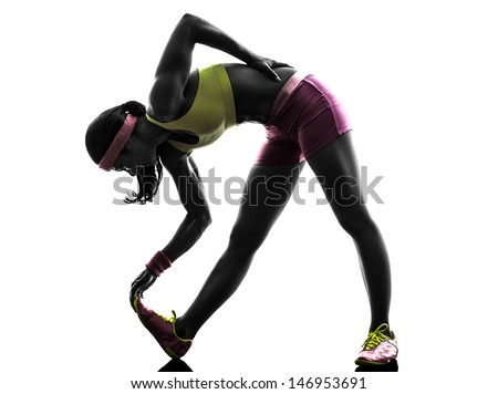 one caucasian woman runner stretching   in silhouette on white background - stock photo