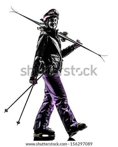 one caucasian woman skier walking in silhouette on white background - stock photo