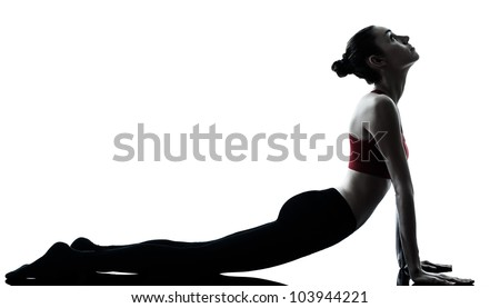 one caucasian woman sun salutation yoga surya namaskar posture position in silhouette in studio isolated on white background full length - stock photo
