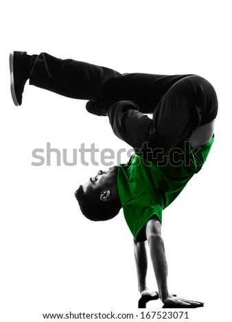 one caucasian young acrobatic break dancer breakdancing man in silhouette  white background - stock photo