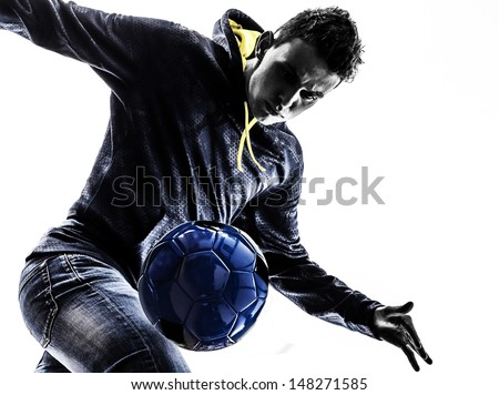 one caucasian young man soccer frestyler player  in silhouette  on white background - stock photo