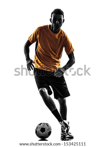 one caucasian young man soccer player orange jersey in silhouette  on white background - stock photo