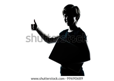 one caucasian young teenager silhouette boy girl holding carrying laptop computer thumb up portrait in studio cut out isolated on white background - stock photo
