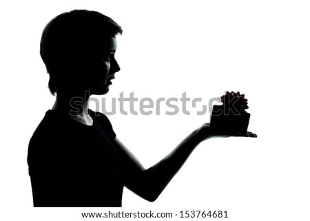 one caucasian young teenager silhouette boy or girl offering present gift  portrait in studio cut out isolated on white background