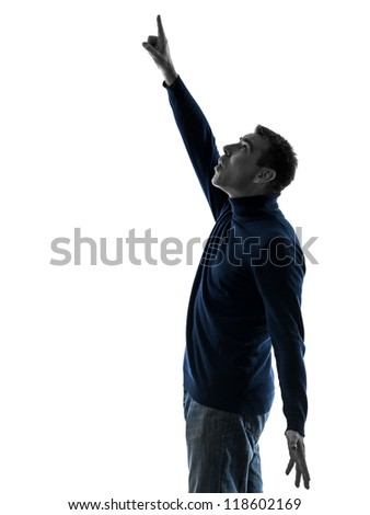 one causasian man pointing up surprised  full length in silhouette studio isolated on white background