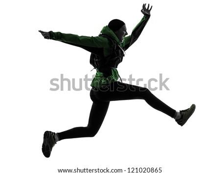 one causasian woman runner running trekking  in silhouette studio isolated on white background - stock photo
