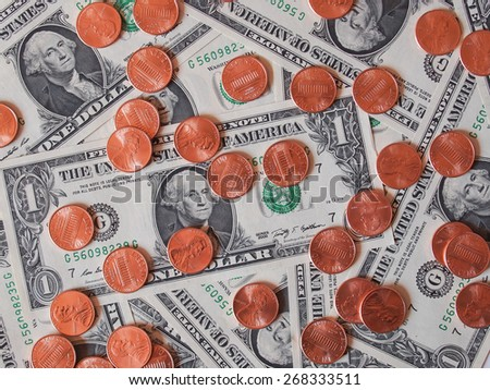 One cent coins and One Dollar banknotes  currency of the United States useful as a background - stock photo