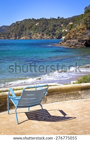 One Chair at the beach. Was seen in the South of France. - stock photo