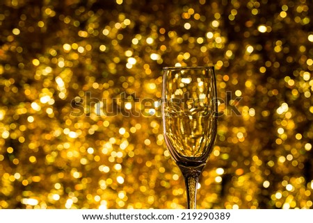 One champagne glass on christmas bokeh background - stock photo