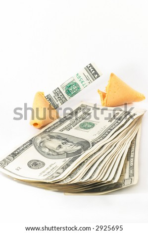 One Chinese Fortune Cookie open with money, cash neatly folded inside the snack, on white background. Serial number of cash removed for security reasons.
