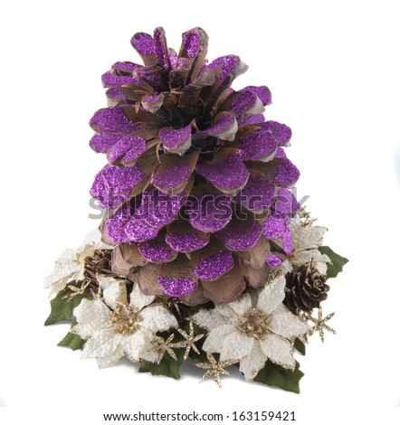 one christmas pineapple painted with magenta glitter on christmas flowers decoration - stock photo