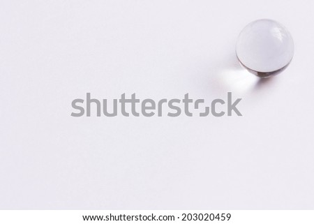 One clear glass marble - Upper right  - stock photo
