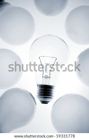 One clear light bulb in group - stock photo
