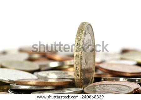 One coin set upright, towers over other - stock photo
