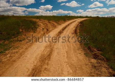 One country road divides into two roads - stock photo