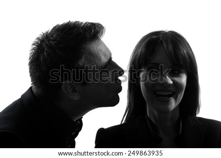 one  couple man kissing woman in silhouette studio isolated on white background - stock photo