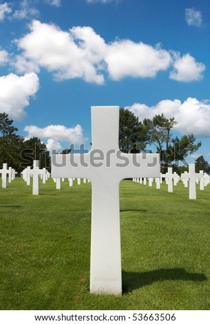 One cross heading a row in the American cemetery of WWII in Normandy, France - stock photo
