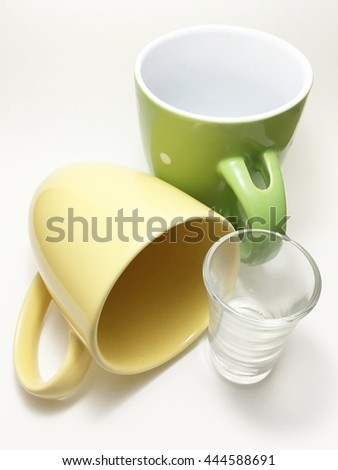 one cup is falling - stock photo