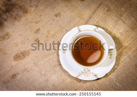One cup of tea on a wooden table - stock photo