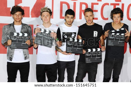 One Direction and director, Morgan Spurlock at the One Direction This is Us film - press conference, London. 19/08/2013 - stock photo
