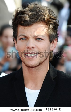 "One Direction singer, Louis Tomlinson arriving for the ""One Direction: This is Us"" World premiere at the Empire, Leicester Square, London. 20/08/2013 - stock photo"