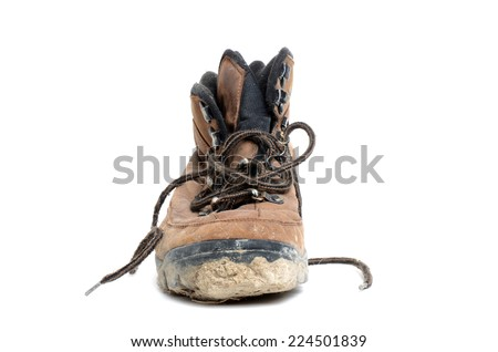 one dirty hiking boot isolated white background - stock photo