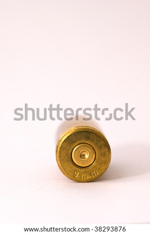 One Dirty 9 mm shell casing primer forward - stock photo
