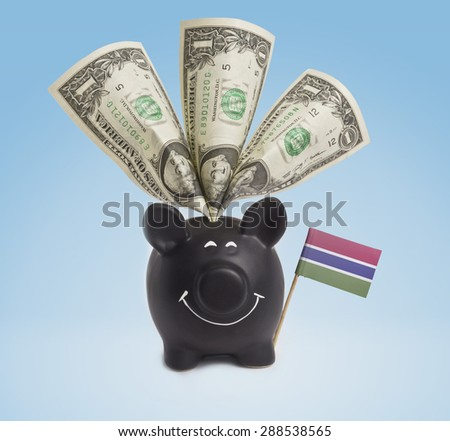 One dollar banknote in a smiling piggybank of Gambia.(series) - stock photo