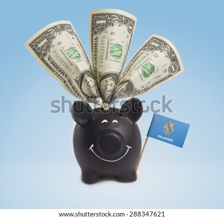 One dollar banknote in a smiling piggybank of Oklahoma.(series) - stock photo