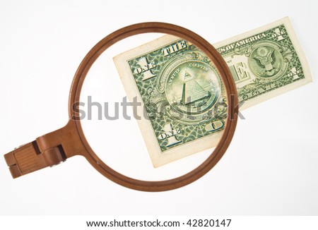 one dollar bill magnified by lens