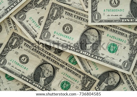 one dollar bill on dollar money background. top view. financial and banking concept.
