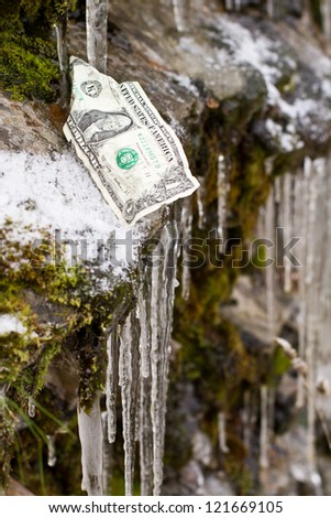 one dollar bill on the edge of a slippery cliff. concept for fiscal cliff - stock photo