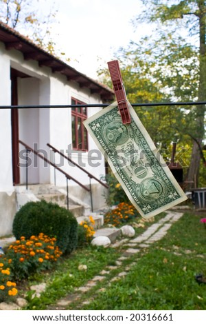 one dollar bill with house on background - stock photo