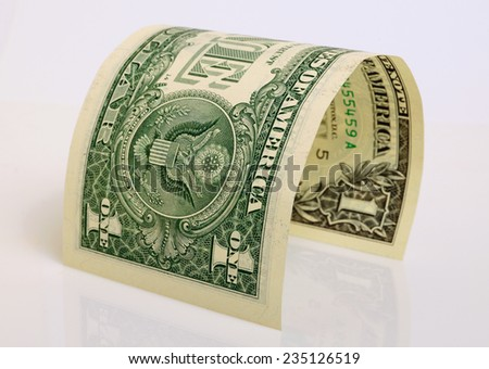 One dollar close up on a light plane. - stock photo
