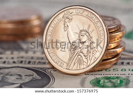 One Dollar Coins and Bills - stock photo