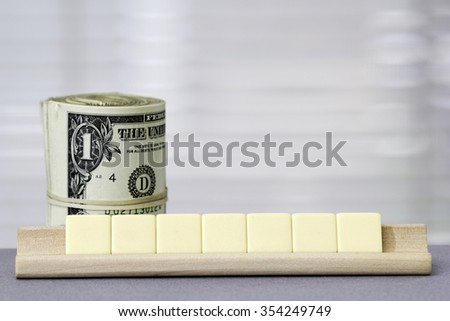One dollar Copy Space for seven letters - stock photo