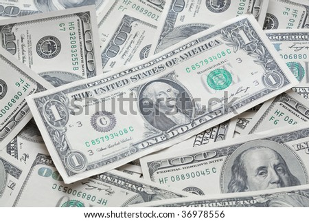 One dollar on one hundred dollars background